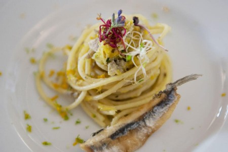 Spaghetti with mediterranean anchovies and a scent of citrus fruits