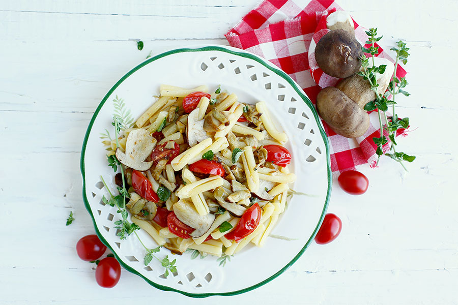 Casarecce with porcini mushrooms, cherry tomatoes and nepitella
